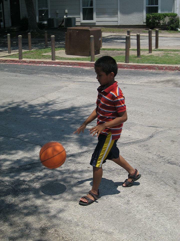 Refugee kid playing soccer